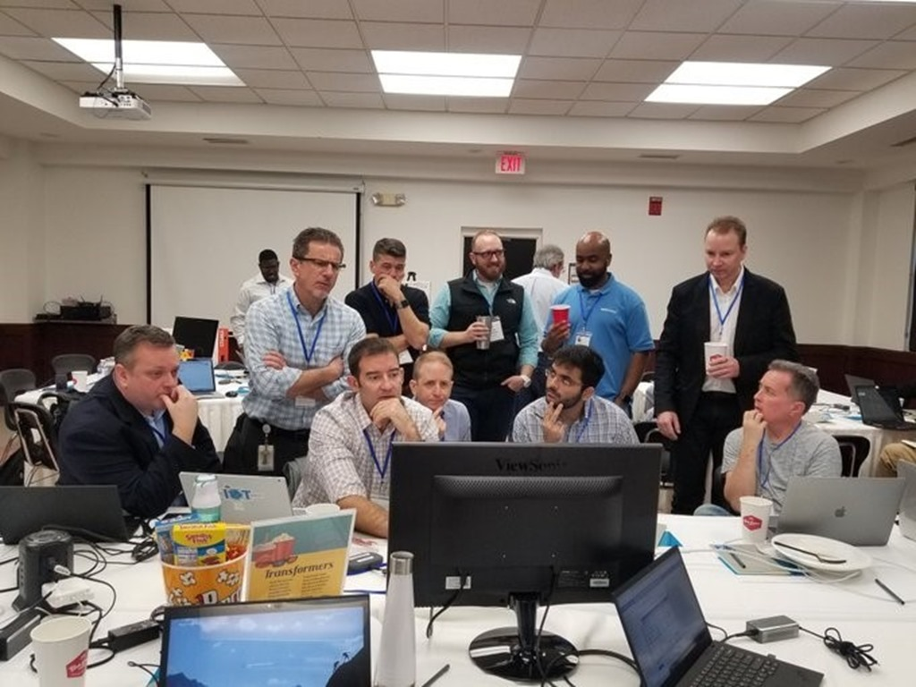 The Town of Cary team working in a conference room with Microsoft and SAS resources.