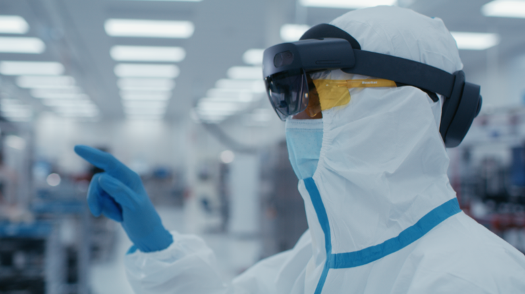 Medical worker in protective gear using Microsoft HoloLens 2